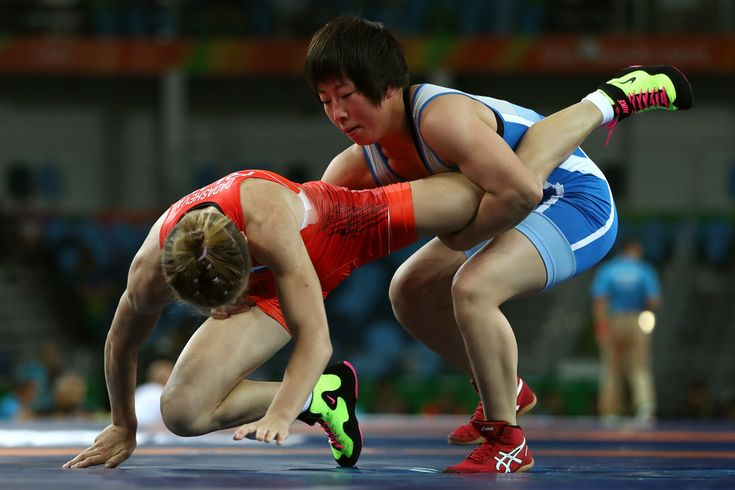Milana Dadasheva (L) of Russia competes against Hyon Gyong Kim of the People's Republic of Korea during a Women's Freestyle 48kg Qualification bout on Day 12 of the Rio 2016 Olympic Games at Caioca Arena 2 on August 17, 2016 in Rio de Janeiro, Brazil.