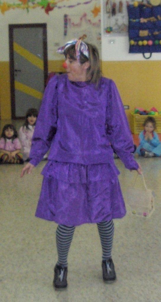 Il pagliaccio Caramella, vestito di prenatal, da notare la borsetta