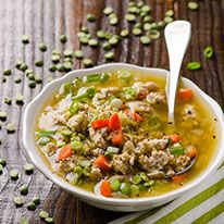 Hearty green split pea soup made healthy with turkey bits and liquid smoke. A clean copycat version of your mom's Ham and Split Pea soup.