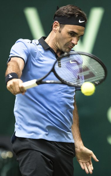 Roger Federer Photos Photos - Roger Federer of Switzerland plays a backhand during his semi final match against Karen Khachanov of Russia during Day 8 of the Gerry Weber Open 2017 at  on June 24, 2017 in Halle, Germany. - Gerry Weber Open - Day 8