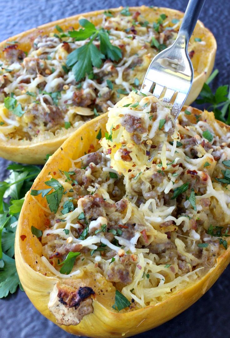 Sausage Spaghetti Squash with Apple Cider Glaze is hitting the dinner table! Sausage, parmesan cheese and reduced apple cider makes this squash a meal!