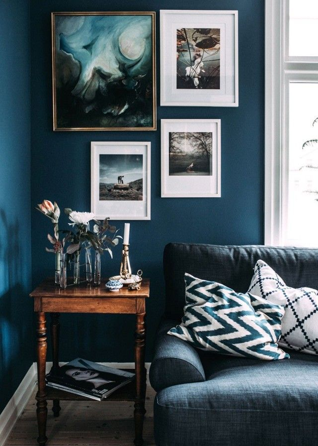 Living Room With Dark Blue Marine Walls Layered Art And A