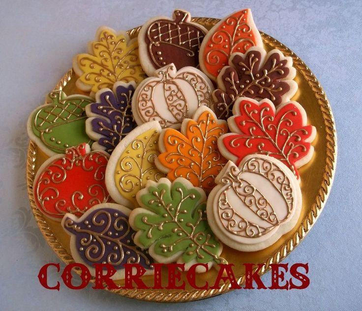 Leaf, acorn and pumpkin decorated sugar cookies. Royal icing. Green, orange, yellow, red, brown, purple, white, gold. Maple, oak, pumpkin, acorn.