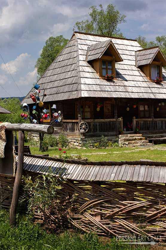 Romanian house with #woven #fence made of #hazel rods in Maramureș county.