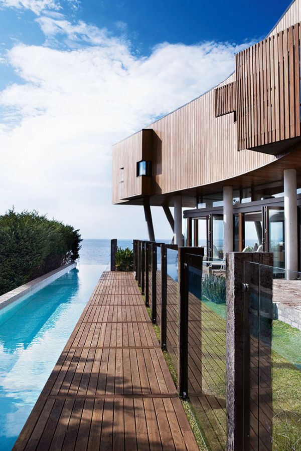 Contemporary waterfront #beach home #architecture with an infinity-edge #pool design