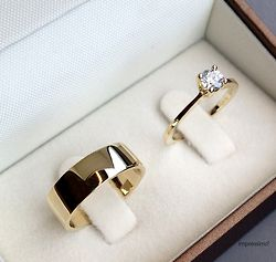 Beautiful! Traditional gold band with diamond engagement ring.