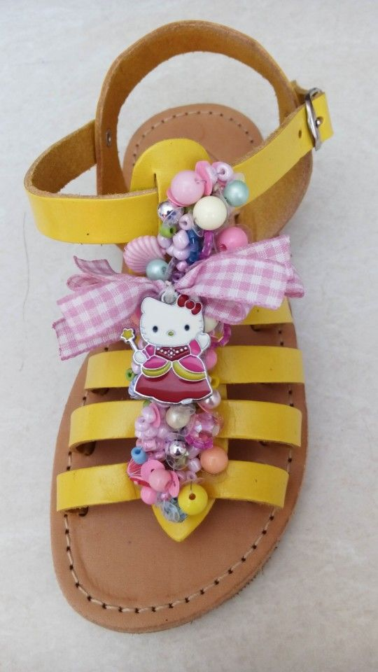 Handmade yellow gladiator sandals with pearls and kitty designed by Elli lyraraki