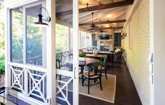 I love the sliding doors on this screened porch!