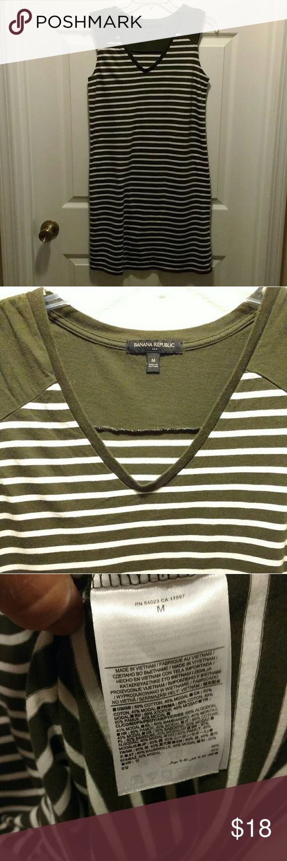 Banana Republic olive green striped dress Olive green and white Banana Republic striped t-shirt dress.  Soft and comfy!  Would look great with leggings and boots! Banana Republic Dresses Midi