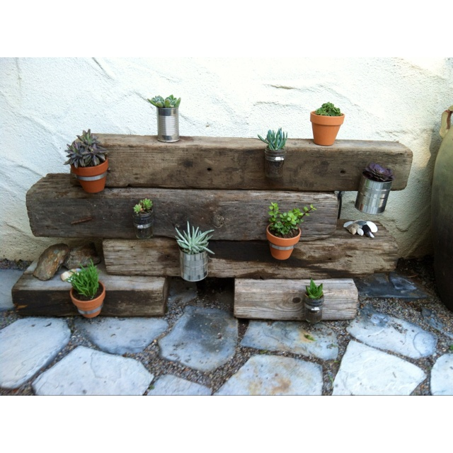 My own twist to the hose clamp garden (instead of the wood pallet or recycled wood).....old railroad ties!!  What a fun, easy afternoon project!!