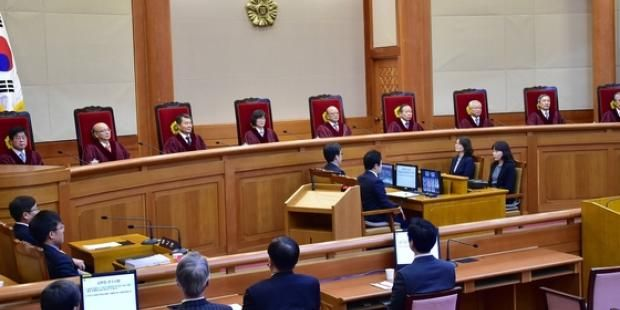Judges in South Korea's Constitutional Court deliver their ruling to dissolve the Unified Progressive Party on 19 December 2014
