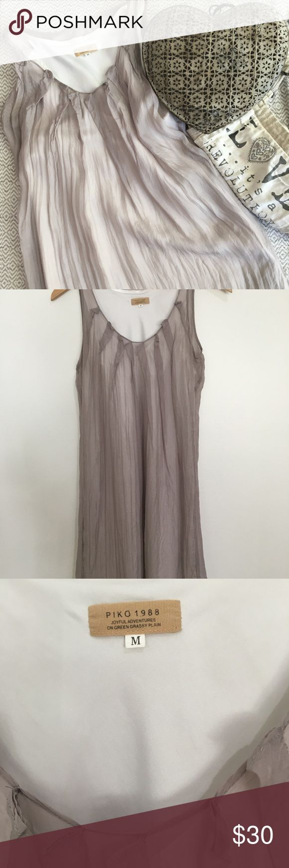 """Piko 1988 silk dress Sheer and flowy light gray 100%silk dress with a white 100% polyester slip. Measures approx: 34.5"""" long and 17"""" armpit-armpit across flat. A tiny stain in the front as shown in picture. Runs more like a small. Overall good condition. Piko 1988 Dresses Midi"""