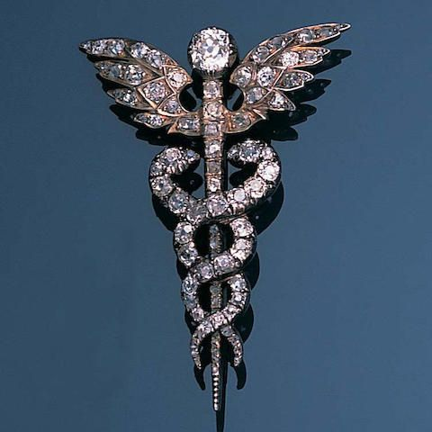 A late 19th century diamond caduceus brooch, circa 1870 The winged staff with two twining serpents set throughout with cushion-shaped, old brilliant and rose-cut diamonds