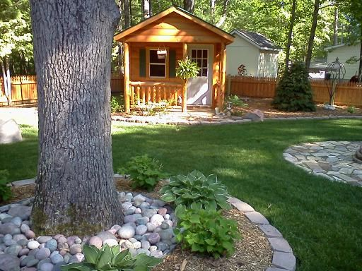 Log cabin landscaping landscaping for a log cabin yard for Lake cabin design ideas