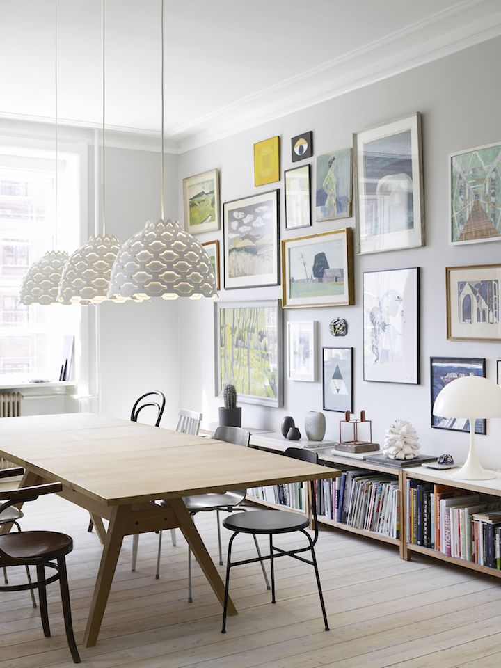 Beautiful simple interiors featuring stunning lights fromLouis Poulsen, especially love the pendants over the dining table, and the gallery wall with low bookcase and lamp.The photos are by Pia Winther for Louis Poulsen, with styling by Lene Ronfeldt via Yellows ~ x debra  Dust Jacket on Bloglovin'