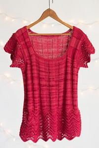 Feather and Fan Ribbed Tee - You will wow when you debut the Feather and Fan Ribbed Tee. This beautiful knit top has a stunning lace bottom that will look fabulous over any pair of jeans. The body of the shirt is made using the stockinette stitch, meaning that with a bit of patience, any knitter can create this stunning wardrobe must-have.