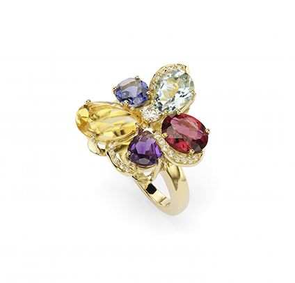 Light in the garden ring. A colorful ring. It is very elegant with its shiny central diamond which gives light to the ring. Photo Ansuini since 1860