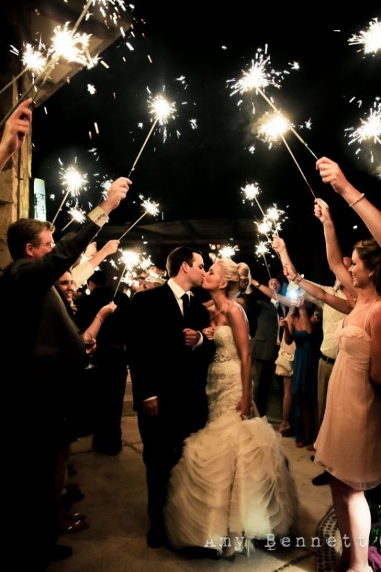 Sparklers light the way for the bride and groom send off.  See more sparklers for weddings and party ideas at www.one-stop-party-ideas.com