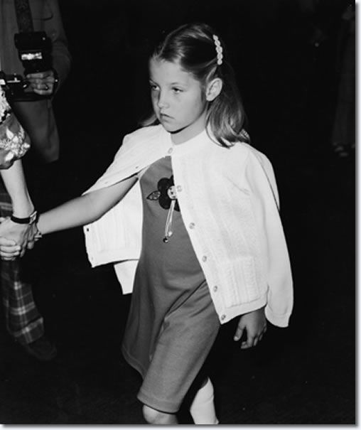 """A nine year old Lisa Marie doesn't look too happy in this photo. Her parents Elvis and Priscilla had divorced roughly four years earlier. Though Priscilla took most of the responsibility in raising their daughter, Lisa Marie did spend a lot of time at Graceland with her father. Here she attended the first ever """"Children's Premiere"""" benefit for the Thalians Community Mental Health Center at Cedars Cinai Medical Center in Los Angeles in March 1977, just months before her father would die"""