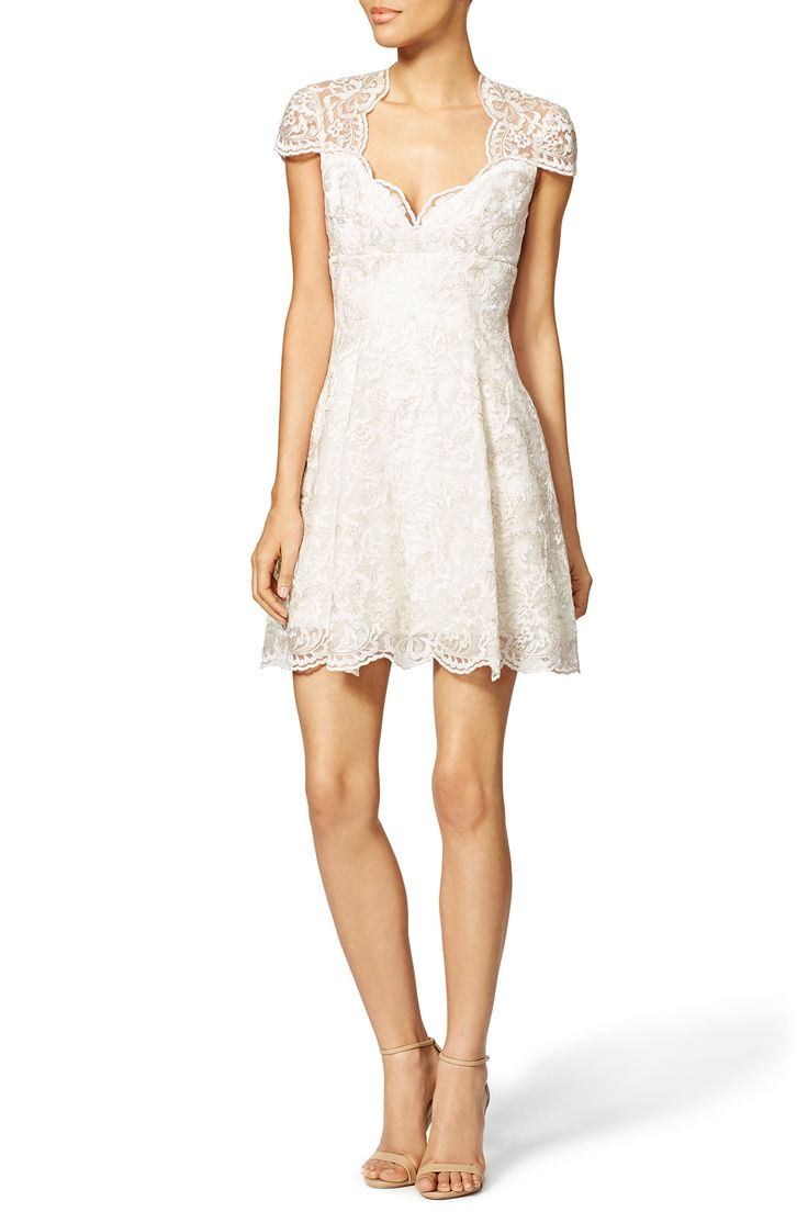 Delicate cap sleeves give this elegant white dress by Marchesa Notte a charming twist for any bride. Accent the intricate design with delicate jewelry and nude stilettos.