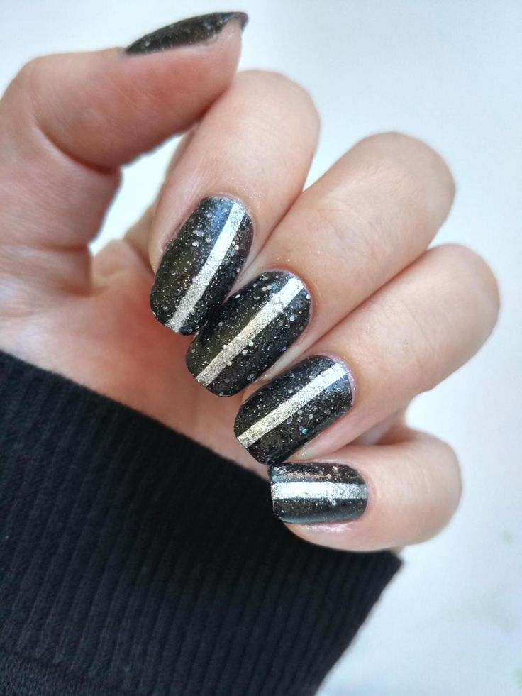 Black and silver space nails, with a graphic twist.