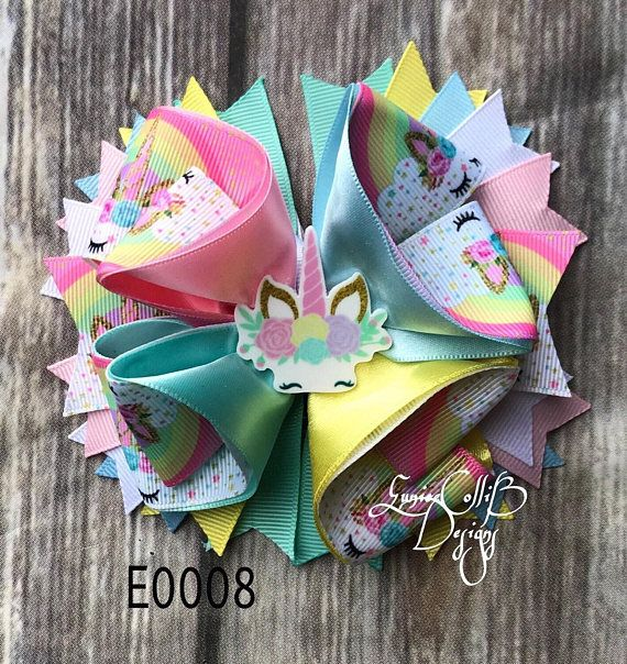Cute bow inspired in Unicorn with nice coordinating colors . Alligator clip 75mm measure approx. 5 ribbons ends are heat sealed to prevent fraying. NOTE PLEASE never leave small children unintended with hairbows., small parts can be a chocking hazard. feel free to ask for custom