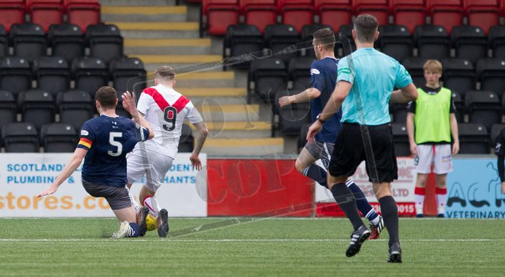 Queen's Park's Ryan McGeever bring Airdrie's Andy Ryan down during the Ladbrokes League One game between Airdrieonians and Queen's Park.