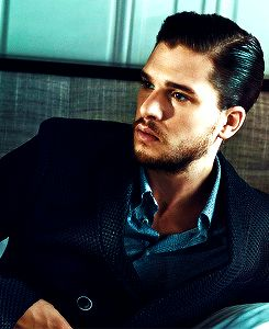 This is what Kit Harrington would look like with short hair. It's just slicked back for the pic. He is under contract NOT to cut his hair.