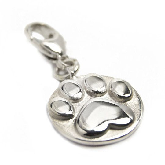 Lovely handmade silver charm in form of a heart shaped cat paw, with a carbiner. Fits perfectly alone or along with other charms on our heart bracelet that you can find in the shop as well. See the example picture!  Size: ~15 mm diameter  Part of the income goes directly to selected shelters for homeless cats.