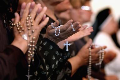 Worshipers pray the rosary at a Catholic church in Baghdad, Iraq. (Wathiq Khuzaie/Getty Images) - (Photo by Wathiq Khuzaie/Getty Images)