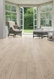 Wideplank wood floors lots of windows and glass doors