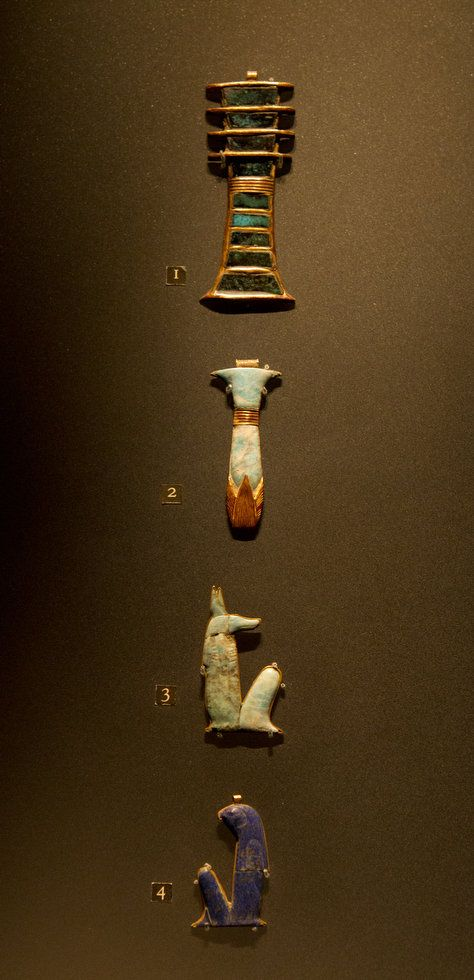 From top to bottom: Djed Pillar Amulet; Winged Ureaus Amulet with Human Head; Vulture Amulet; and Double Ureaus Amulet.