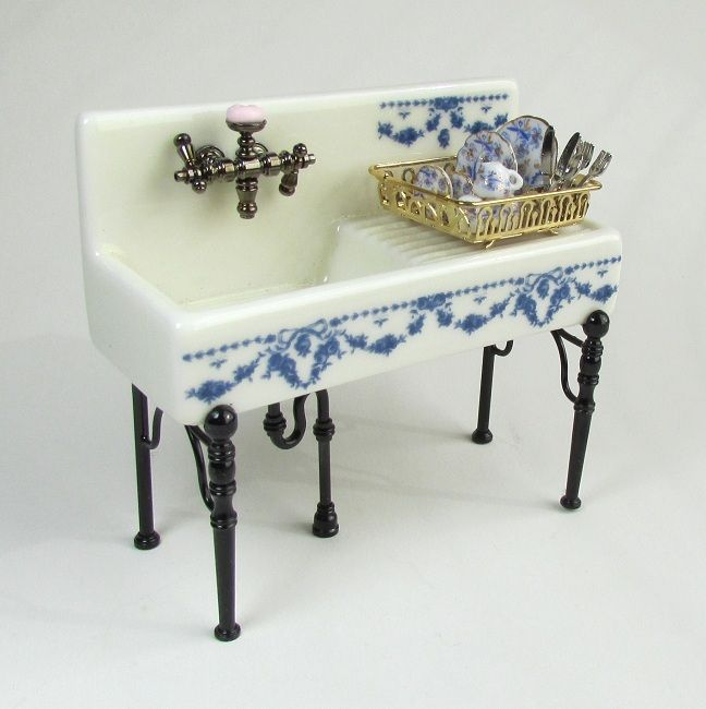 Reutter Porcelain's miniature kitchen sink...