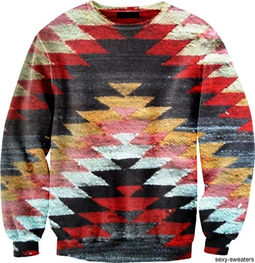 Similar print on the body but maybe on one half. No print on sleeves. Looser fit and longer fit.