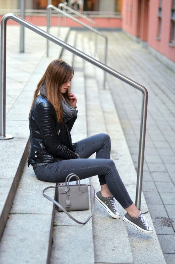 Mixing different shades of black and grey, Barbora Ondrackova is smashing the monochrome trend! We love this casual outfit, consisting of a scarf, leather jacket, jeans and ankle high converse. Jacket: Chiquelle, Jeans: Topshop, Shoes: Converse, Bag: Saint Laurent, Watch: Marc Jacobs, Scarf: H&M.