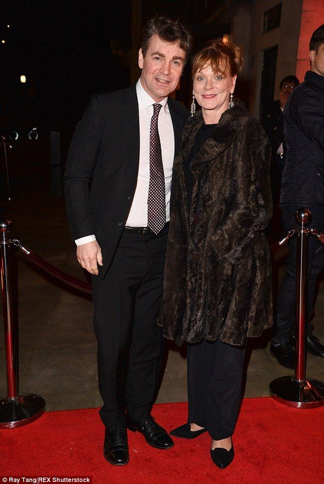Date night: Samantha Bond was also wrapped up in a cosy coat as she joined her husband Ale...