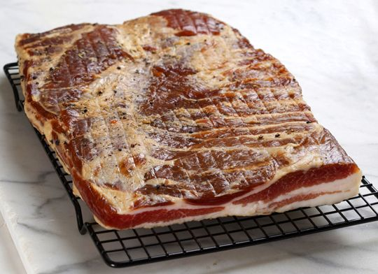 Made a batch of this bacon last week.  Smoked it in my little home-made cold smoker.  It was....awesome.  Little salty - next time I'll add more sugar.  I think I'm going to try a maple cure with applewood smoke next time.