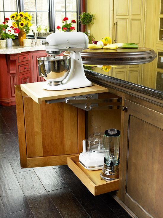 Island storage conceals small appliances while keeping them close to the action. Here, a lockable heavy-duty mixer lift brings the stand mixer up to countertop height.