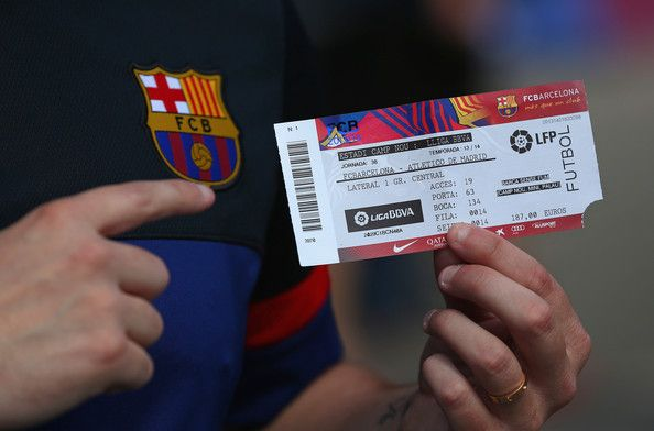 A supporter of FC Barcelona shows off his match ticket prior to the La Liga match between FC Barcelona and Club Atletico de Madrid at Camp Nou on May 17, 2014 in Barcelona, Catalonia.