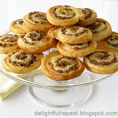 Harrell's Sausage Pin Wheels 2 1/2 cups bisquick mixed with 2/3 cup milk. shape dough into a rectangle and spread 1 lb of bulk sausage on it. Roll it up and refrigerate or freeze. When ready to bake: preheat oven to 350 degrees and thinly slice. Bake for about 10 minutes.