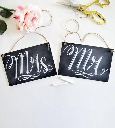 A lovely pair of signs for your special day, these realistic chalkboard chair signs announce the brand new Mr. and Mrs. Printed on real chalkboard, the hand drawn calligraphy design gives it an elegant look and the printing preserves the lettering. Made with sturdy chalkboard materials, the sign hangs from a twine hanger.