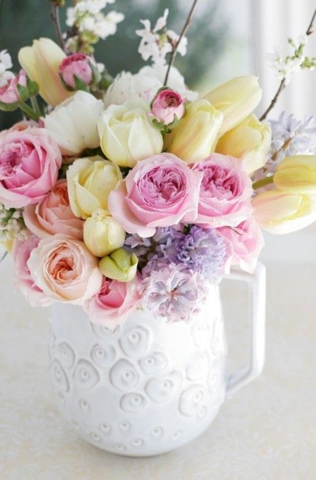::love these Spring Flowers in white, peach, purple and yellow. The white vase is super chic too. perfect for a desktop or kitchen::