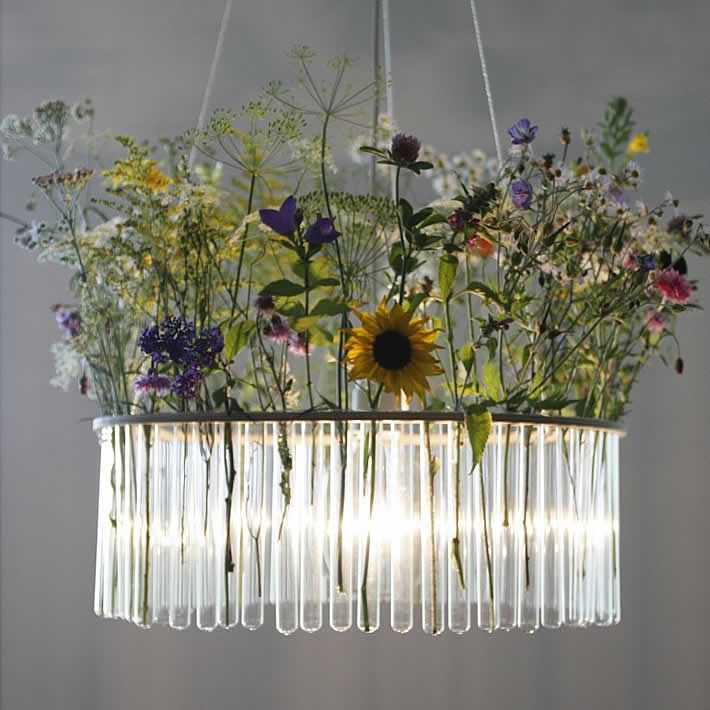 Upcycled test tubes.  Polish artist and designer Pani Jurek created a stunning chandelier by upcycling test tubes into the Maria S.C. chandelier.