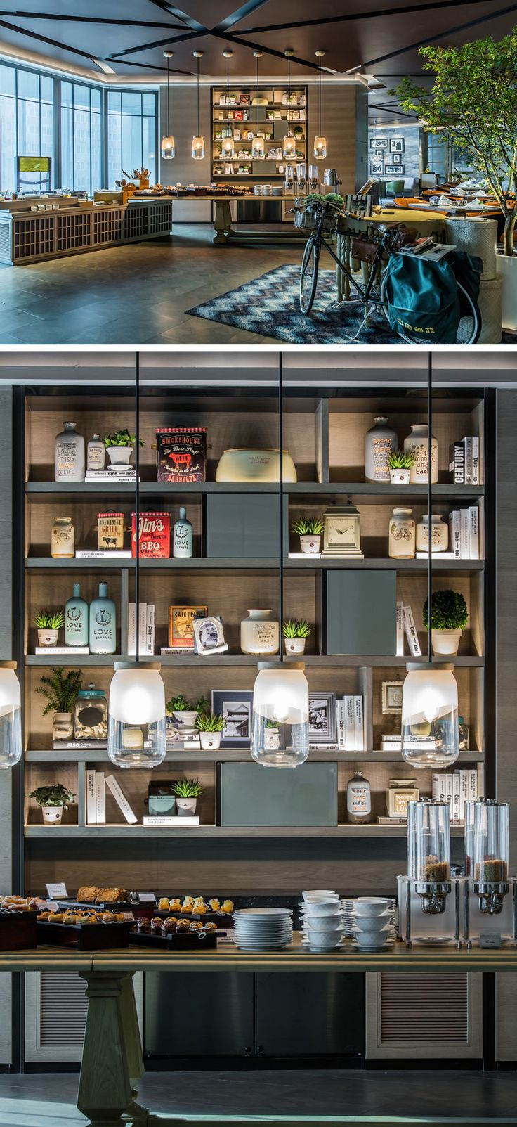 In this modern hotel restaurant, jar-like pendant lights hang above the self-serve counter located in front of a bookcase, that's filled with recipe books and trinkets reminiscent of a home kitchen.