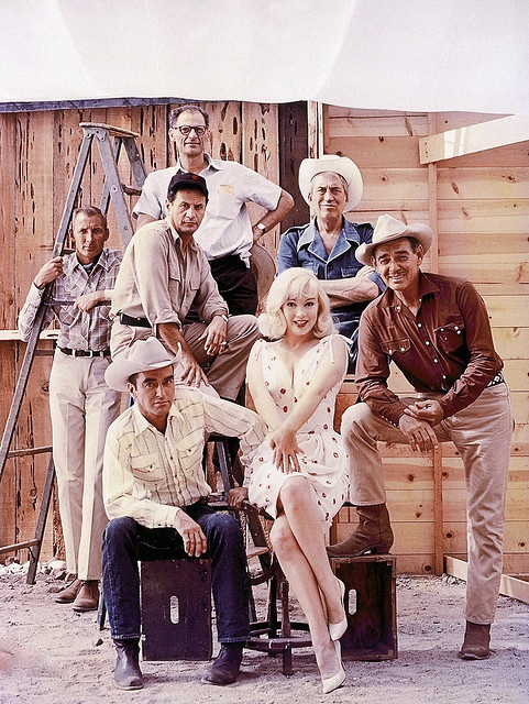 The cast and crew of John Huston's 'The Misfits' line up for a publicity shoot. The group includes writer Arthur Miller, director John Huston, and actors Eli Wallach, Montgomery Clift, Marilyn Monroe and Clark Gable. Photo by Ernst Haas,1960.