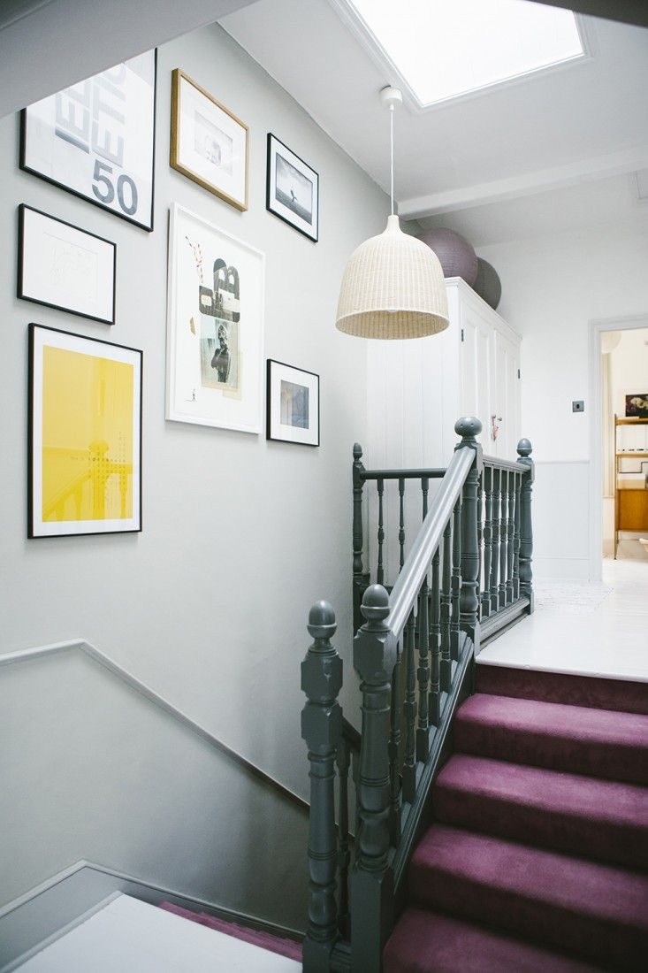 Stairwell with large scaled framed artwork