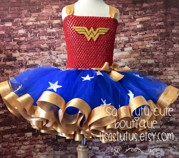 Please read all before purchase.  Give your little girl the treat of a lifetime! Let her celebrate in this Wonder Woman inspired ribbon trimmed tutu dress! Dress comes on a stretch crochet top with attached tutu. Perfect for that birthday celebration, Halloween, or every day dress up! My dresses have been kid tested and mother approved! They can take the hard play! You can find the matching Wonder Woman crown and wristlets at the link provided…
