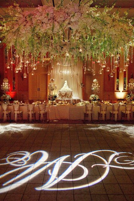 10 best wedding surabaya decoration images on pinterest surabaya cake table display behind lovely banquet head table decor included floral chandelier monogram gobo and crystals another beautiful stardust wedding junglespirit Image collections