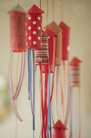 Previous pinned -Cute and easy! Cover toilet paper rolls in fabric, attach ribbon and hang for a space party --my idea: would be cool to make fourth of July decorations . Instead of fabric , tissue paper could be used .