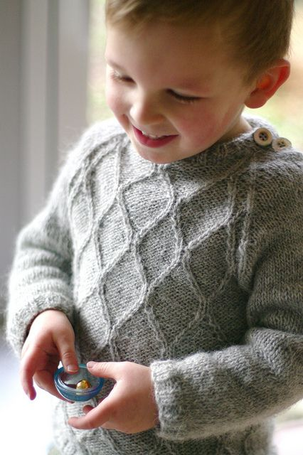 Lancelot by Solenn Couix-Loarer. Love twisted stitch patterns. Would love an adult variation of this sweater.
